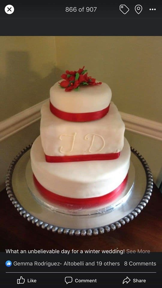 wedding cake with red trim
